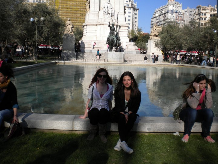 Beth shares a relaxing moment at a fountain in Madrid.