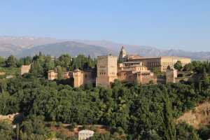 The Alhambra was built in 889 on Roman ruins, renovated and rebuilt in the 13th century by the Nasrid Caliphate and then taken over by King Ferdinand and Queen Isabella of Spain at the conclusion of the Christian Reconquista in 1492